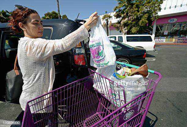 A shopper uses plastic grocery bags after shopping at the 99 Cents Only Store on June 18 2013 in Los Angeles California The Los Angeles City Council...