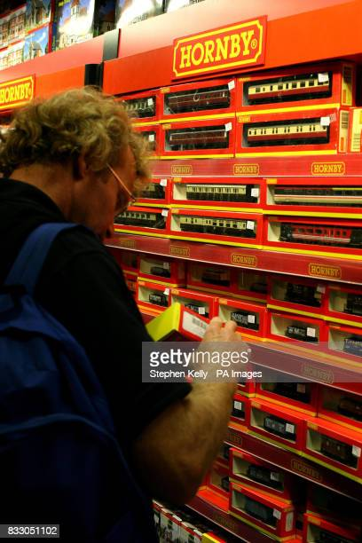 A shopper views a HORNBY train set in a toy shop in central London