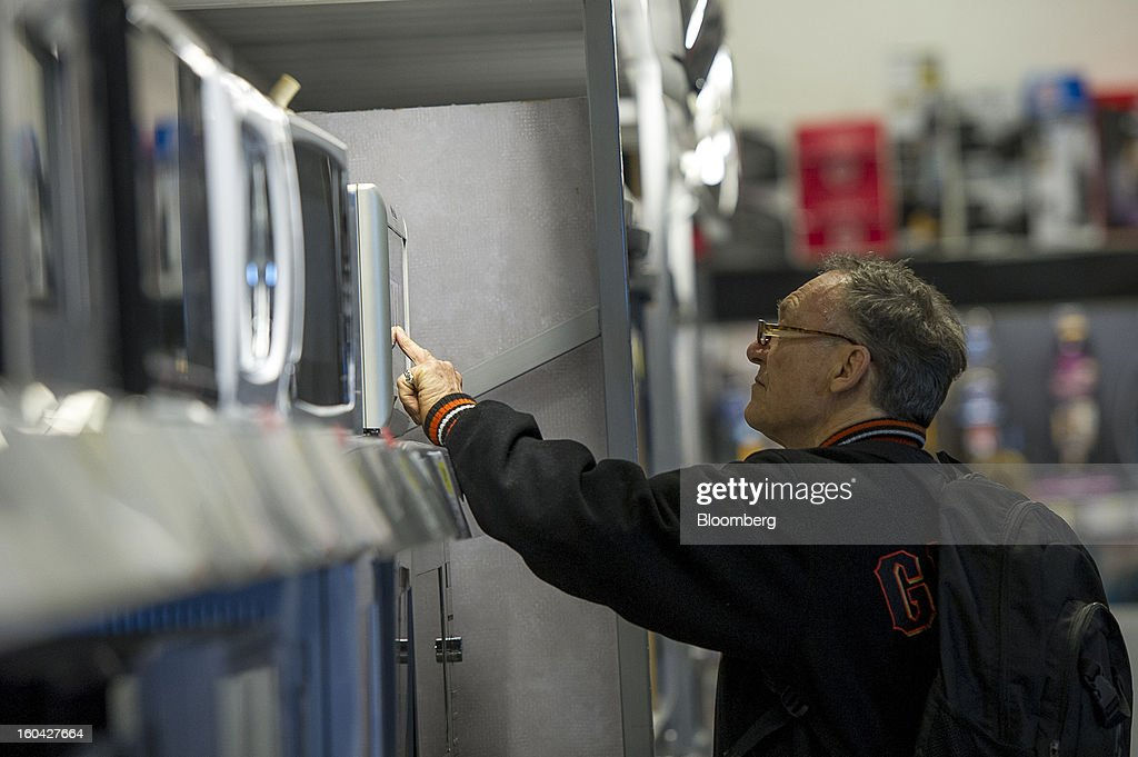 A shopper views a microwave at a Best Buy Co. store in San Francisco, California, U.S. on Wednesday, Jan. 30, 2013. Consumer spending in the U.S. climbed in December as incomes grew by the most in eight years, a sign the biggest part of the economy was contributing to the expansion as the year drew to a close. Photographer: David Paul Morris/Bloomberg via Getty Images