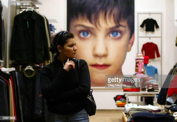 A shopper walks in an Italian store known as Benetton October 10 2003 in Baku Azerbaijan Many Western companies continue to open businesses in...