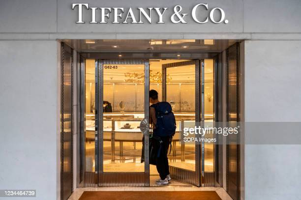 Shopper walks in at the American luxury jewelry company Tiffany & Co store in Hong Kong.