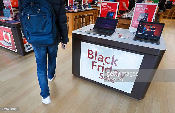 A shopper walks into the Microsoft Store at the City Creek Center looking for 'Black Friday' deals on November 25 2016 in Salt Lake City Utah The day...