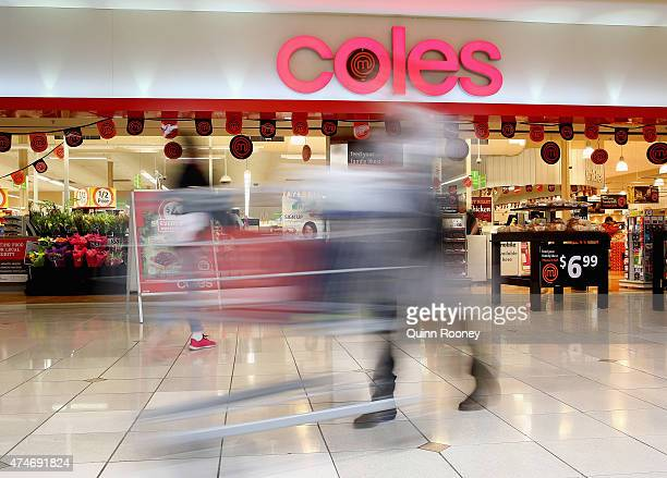 A shopper walks out of Coles supermarket on May 25 2015 in Melbourne Australia In a bid to regain its title as Australia's distinguished retailer...