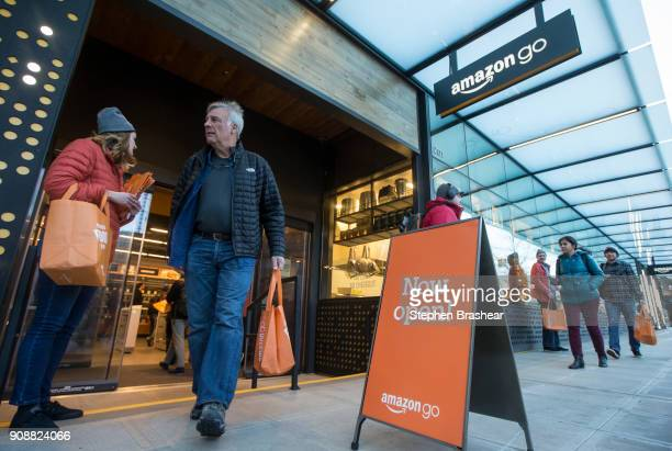 A shopper walks out the the Amazon Go store on January 22 2018 in Seattle Washington After more than a year in beta Amazon opened the cashierless...
