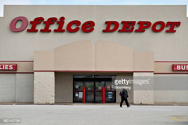 Shopper walks outside of an Office Depot Inc. Store in Peoria, Illinois, U.S., on Tuesday, Feb. 19, 2013. Office Depot Inc. And OfficeMax Inc. Are...