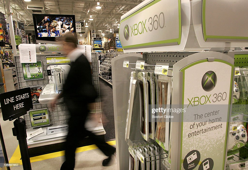 A shopper walks past a display for the XBox 360 at the Best