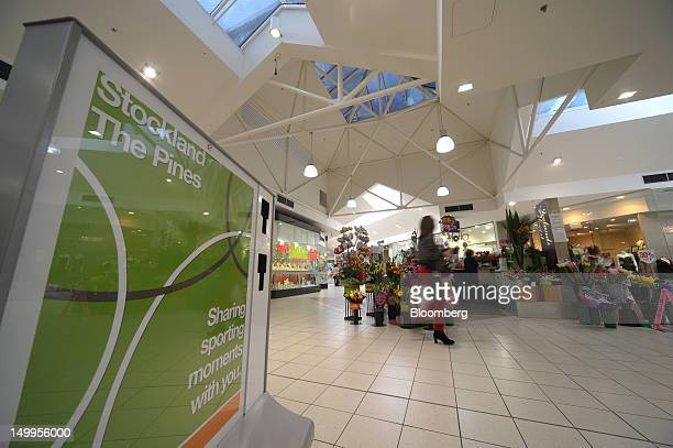 A shopper walks past a florist stall in Stockland's The Pines shopping centre in Doncaster East an outer suburb of Melbourne Australia on Monday Aug...