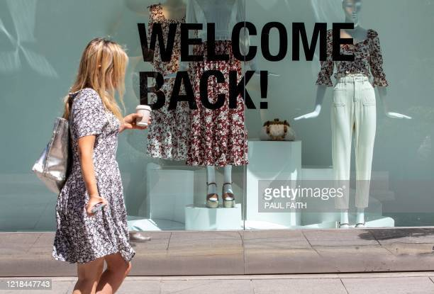 """Shopper walks past a sign reading """"Welcome Back"""" in the window display of a re-opened Zara shop in Grafton Street in central Dublin, Ireland on June..."""