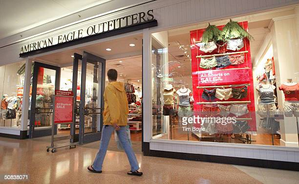 Shopper walks past an American Eagle Outfitters clothing store May 14, 2004 at a shopping mall in Mount Prospect, Illinois. American Eagle Outfitters...