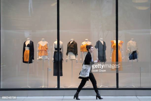 A shopper walks past an HM store on Michigan Avenue on May 30 2017 in Chicago Illinois US consumer spending rose 04 percent in April the best since...