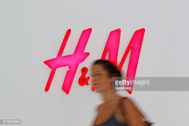 A shopper walks past the logo for Hennes Mauritz AB inside the Westfield Chatswood shopping center operated by Scentre Group in Sydney Australia on...