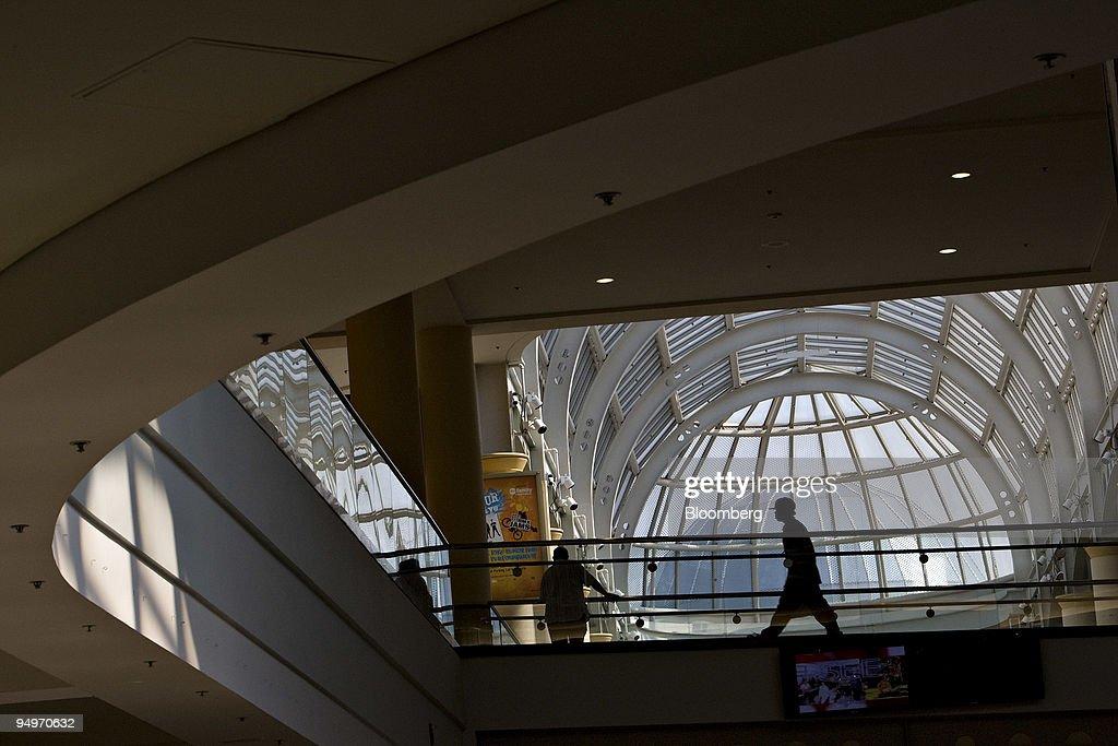 A shopper walks through Roosevelt Field Mall in Garden City