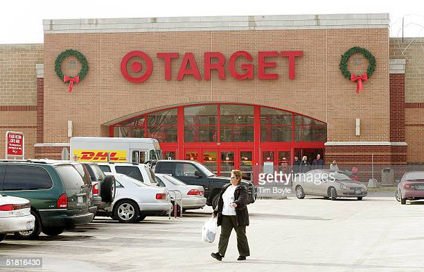 Shopper walks through the parking lot of a Target store December 2, 2004 in Rosemont, Illinois. Several major national retailers have banned...