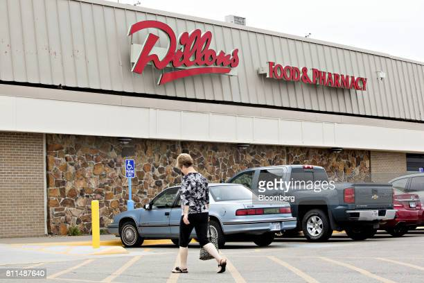 A shopper walks to a Dillons Food Stores supermarket owned by Kroger Co in Hays Kansas US on Thursday June 29 2017 Kroger remains committed to its...