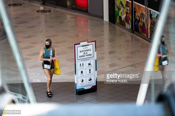 Shopper wearing a facemask walks through the Mall of America on June 16, 2020 in Bloomington, Minnesota, after some of the shops at the mall reopened...