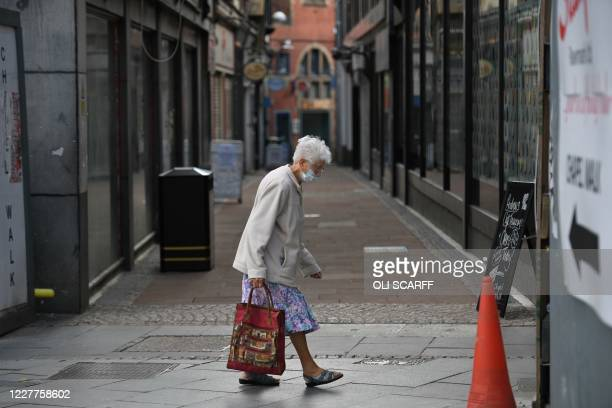 Shopper wears a face mask in the city centre of Sheffield, south Yorkshire on July 24 as lockdown restrictions continue to be eased during the novel...