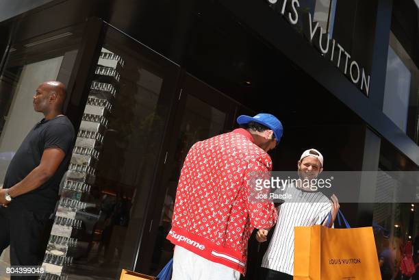 A shopper wears a new Supreme shirt as people flock to the Louis Vuitton store to purchase limited edition supreme and Louis Vuitton collaboration...