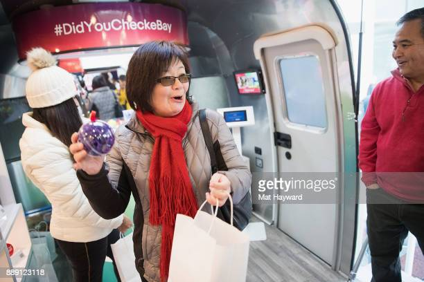 A shopper wins a prize from the eBay Claw Machine during the 'Did You Check eBay' Holiday Airstream tour at Westlake Center Plaza on December 9 2017...