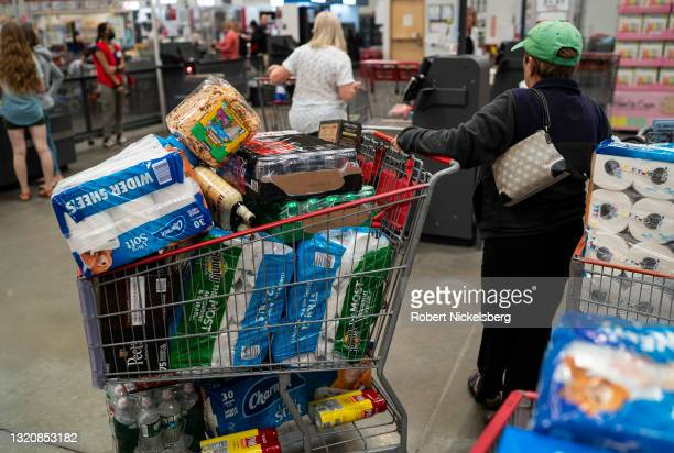 Shopper with a full cart waits to check out at a Costco Wholesale store May 25, 2021 in Colchester, Vermont. Costco reported a surge in its 2021...