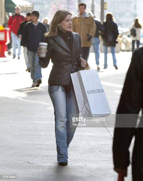 Shopper with her Nordstrom shopping bag walks down Michigan Ave. November 21, 2003 in Chicago, Illinois. The official start of the Holiday shopping...