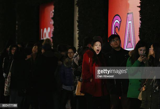 A shopper yawns as she queues outside Selfridges ahead of the Boxing Day sales on December 26 2015 in London England Boxing Day is one of the busiest...