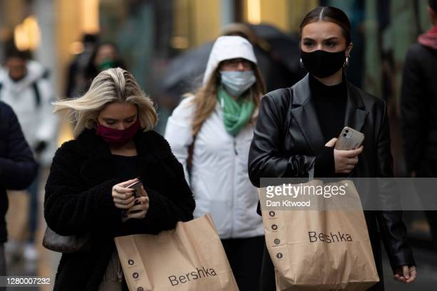 Shoppers and commuters around Oxford Street on October 13, 2020 in London, England. London Mayor Sadiq Khan said today that the city would move into...