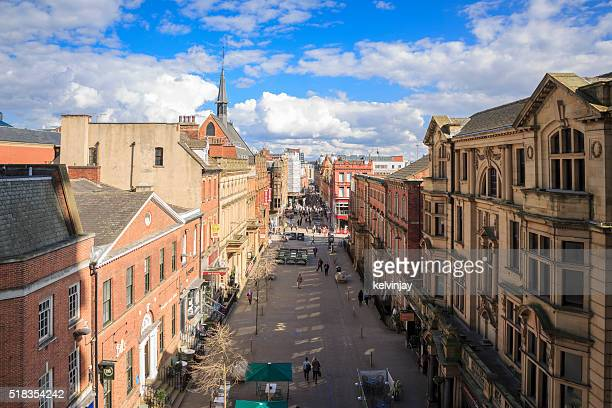 shoppers and other pedestrians walking through leeds, west yorkshire - leeds stock pictures, royalty-free photos & images