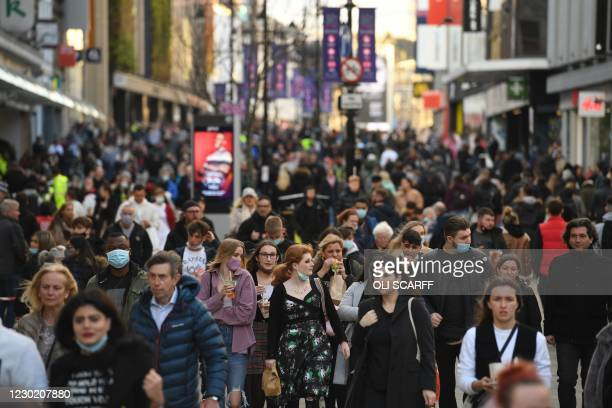 Shoppers and pedestrians fill Northumberland Street in Newcastle-upon-Tyne, in north-east England on December 19 on the last Saturday before...