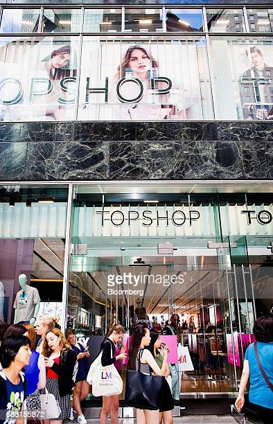 Shoppers and pedestrians pass in front of a Top Shop Ltd store on New York US on Tuesday July 19 2016 The Bloomberg Consumer Comfort Index a survey...