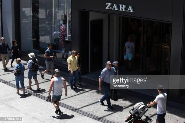 Shoppers and pedestrians walk past a Zara fashion store operated by Industria de Diseno Textil SA at Queen Street Mall in Brisbane Australia on...