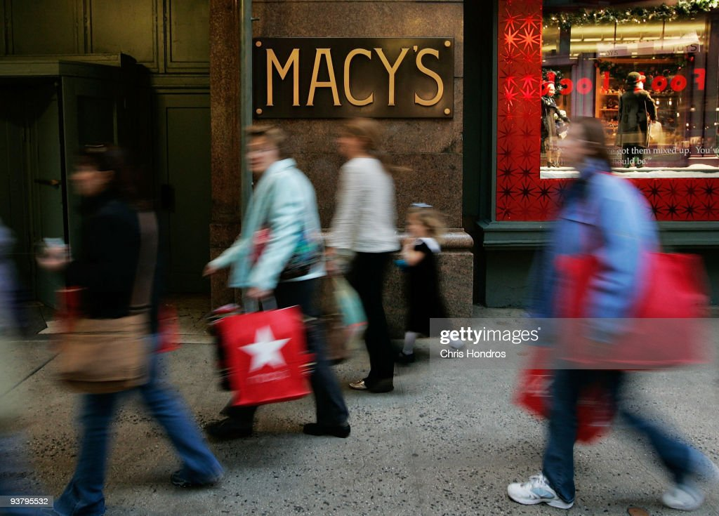 Shoppers and pedestrians walk past an extrance to Macy's December 3, 2009 in New York City. Retail sales declined 0.3 percent, with Macy's dopping 6.1 percent, in November, leading some analysts to fear that the holiday season will not live up to expectations.