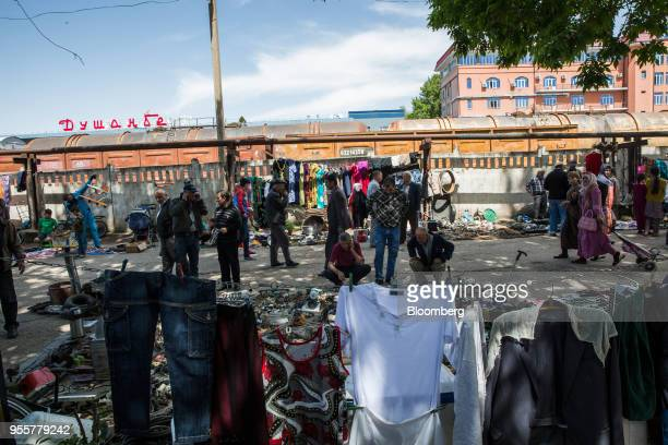 Shoppers and pedestrians walk past stalls at a market in Dushanbe Tajikistan on Sunday April 22 2018 Flung into independence after the Soviet Union...