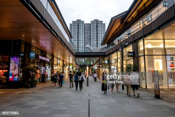 Shoppers and tourists in Chengdu SinoOcean Taikoo Li Incorporating modern design styles and fashion elements into the traditional local architectures...