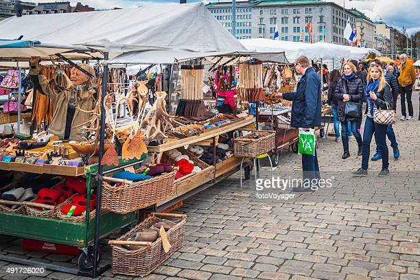 Shoppers and traders stalls in Helsinki Market Square Kauppatori Finland