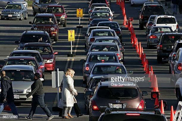 Shoppers and traffic mix in the parking lot November 25 2005 at Leesburg Corner Premium Outlets in Leesburg VA The Friday after Thanksgiving is...