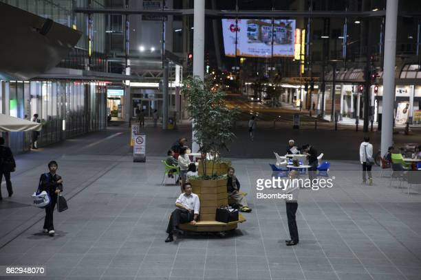 Shoppers and visitors gather in front of a shopping complex in Fukui Japan on Tuesday Oct 10 2017 Fukui Prefecture has one of the lowest rates of...