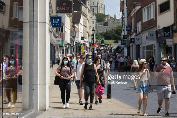 Shoppers and visitors, some of whom wearing face coverings, are pictured close to Windsor Castle on 'Freedom Day', when the UK government lifted...