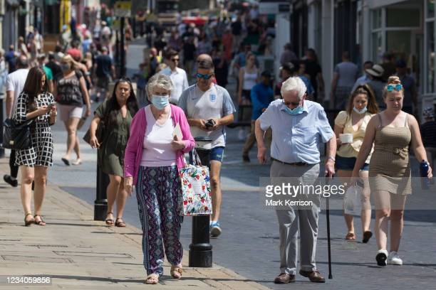 Shoppers and visitors, some of whom wearing face coverings, are pictured on 'Freedom Day', when the UK government lifted almost all remaining...