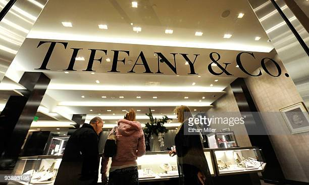 Shoppers appear at the Tiffany Co store during the grand opening of Crystals at CityCenter the project's 500000squarefoot retail and entertainment...