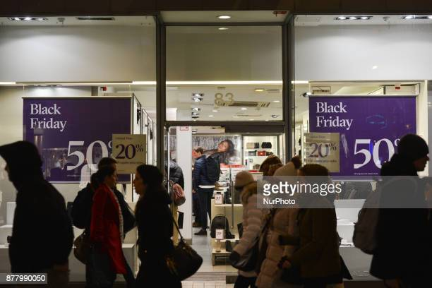 Shoppers are checking products and prices on Grafton Street ahead of the Black Friday regarded as the beginning of the Christmas shopping season...