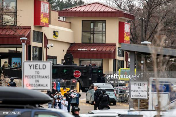 Shoppers are escorted out of a King Soopers grocery where a gunman opened fire on March 22, 2021 in Boulder, Colorado. Dozens of police responded to...