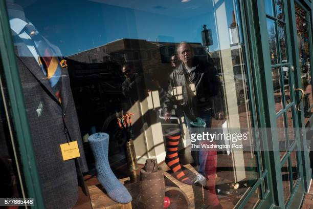 Shoppers are reflected in the windows of Highcliffe Clothiers on Tuesday November 21 2017 in Middleburg Virginia Middleburg is seeing a seeing a...