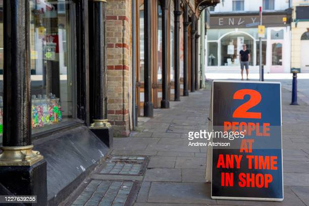 Shoppers are reminded that its only two people at any time in the sweet shop in Folkestone town centre on the 15th of June 2020 the day the shops...