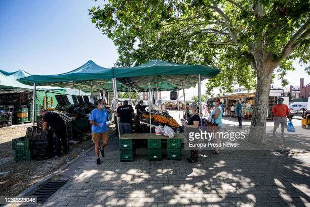 Shoppers are seen at the recently reopened San Fernando de Henares municipal market with a reduction in the number of stalls on May 29 2020 in San...