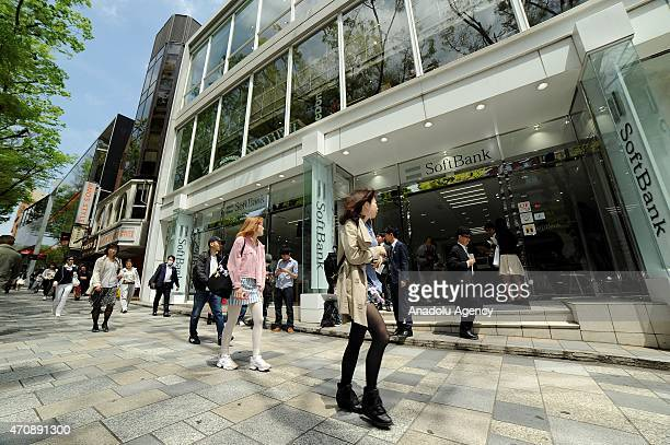 Shoppers are seen in front of a Softbank store in Tokyo on April 24 2015 Apple sold its first Apple Watch at the highend shopping district of...