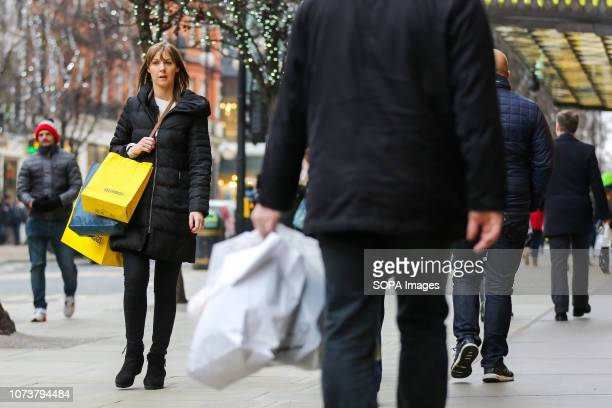 Shoppers are seen on Londons Oxford Street with shopping bags with 9 days to Christmas Day Retailers are expecting a rush of shoppers in the leadup...