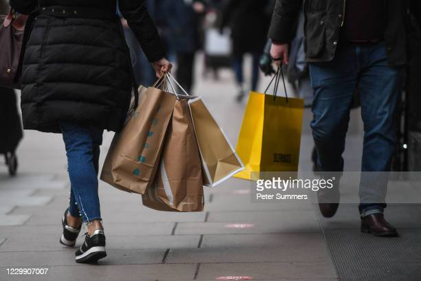 Shoppers are seen on Oxford Street on December 2, 2020 in London, England. Last night MPs voted in favour of government proposals to enter England...
