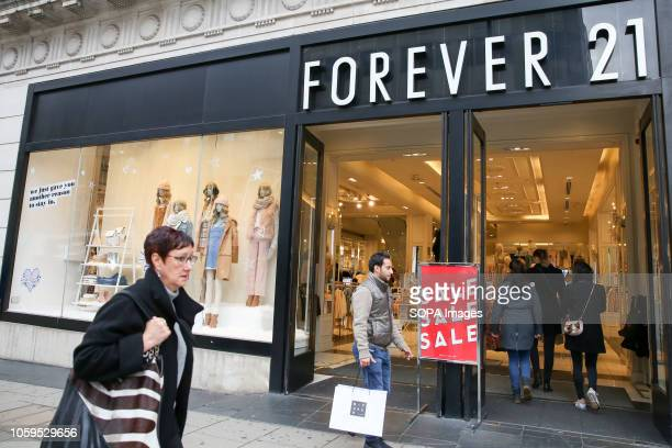 Shoppers are seen outside Forever 21 store on London's Oxford Street. The retail sector faces difficulties as consumers cut down on spending and do...