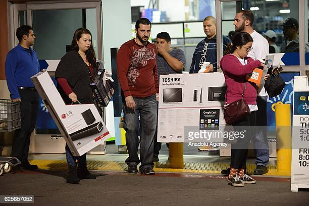 Shoppers are seen outside the 'Target' shopping mall during the sales on a day before 'Black Friday' in Los Angeles USA on November 24 2016 The day...