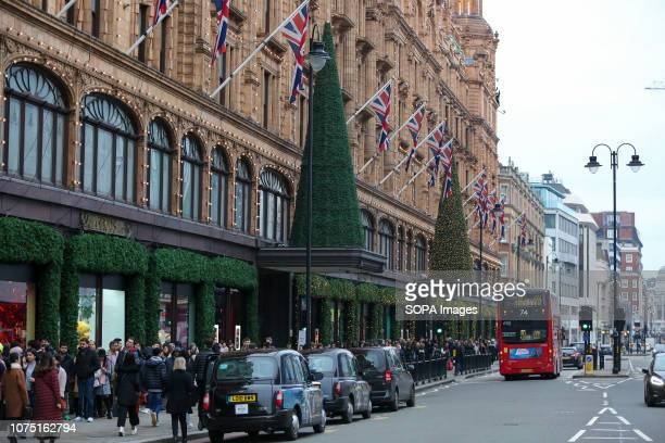 Shoppers are seen queuing outside the luxury department store Harrods in Knightsbridge for the Boxing Day sales. Boxing Day is one of the busiest...
